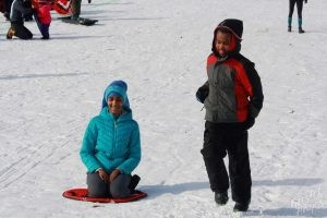 Welcome to Winter Festival | Kids Running and Sledding