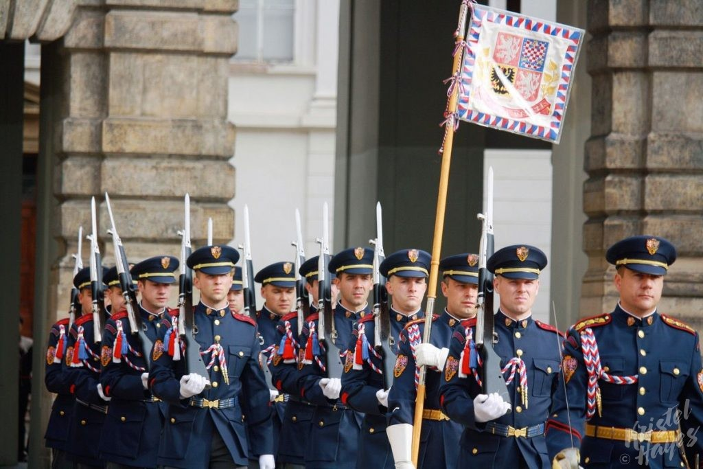 Men carrying flag during changing of the guard ceremony at Prague Castle
