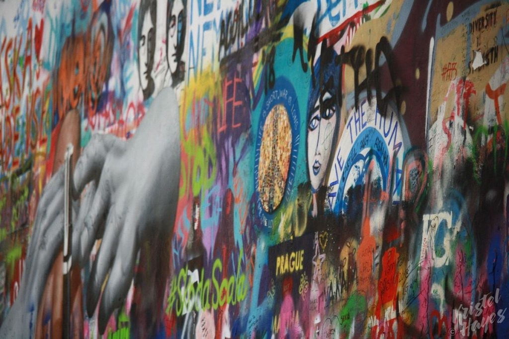 Layers of graffiti art at the John Lennon Wall